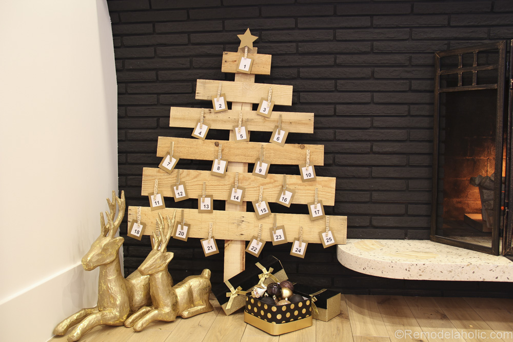 Remodelaholic | DIY Pallet Wood Christmas Tree Advent Calendar; Day 11