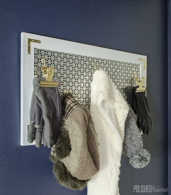 A modern take on pegboard for a hook and clip rack for coats, hats, and scarves Polished Habitat
