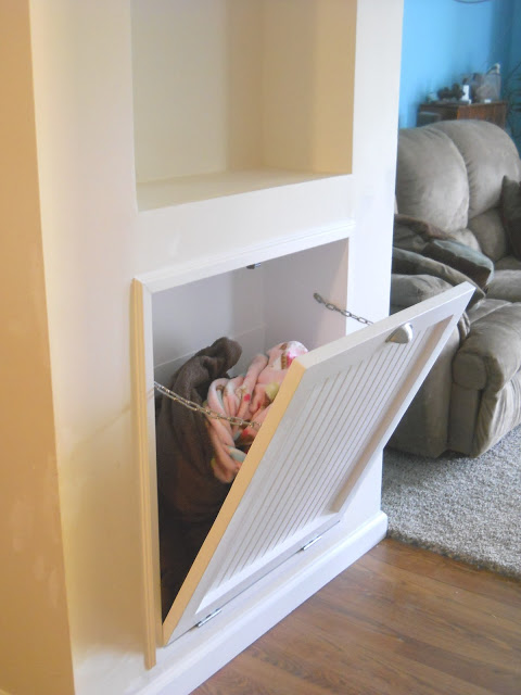 built in storage space for blankets, this is so smart