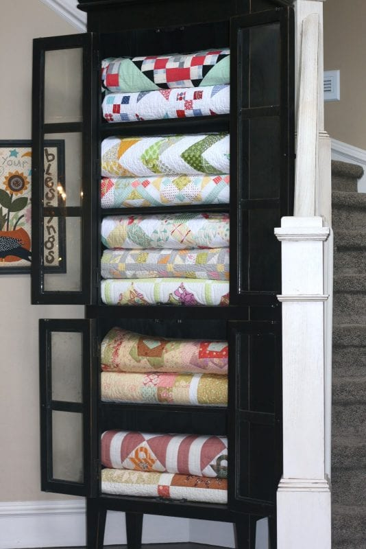 Beautiful! Store quilts in a china cabinet for easy access and nice looking blanket storage.