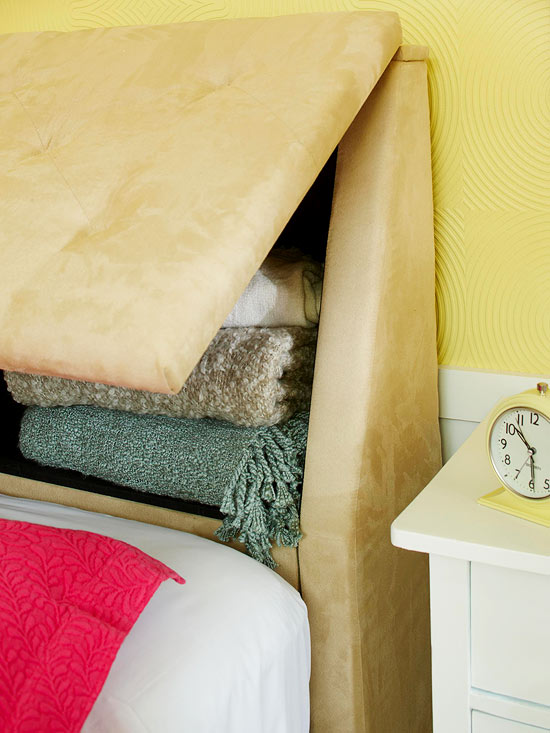 I need to find one of these storage headboards! Love this!