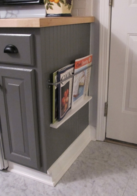 small space saving rack on the side of the cabinet, for cookbooks or magazines White Tulip Designs