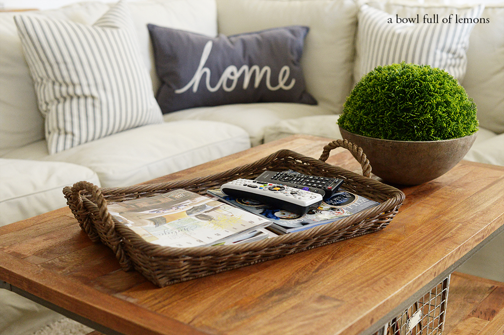 Fabulous use a coffee table tray to corral remotes and magazines