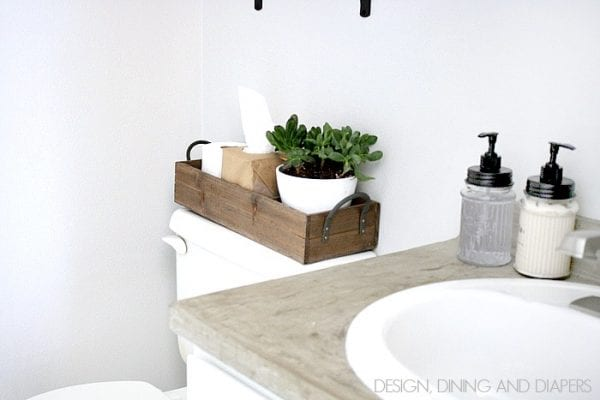 use a wooden tray to organize items on the back of the toilet in a small bathroom Design Dining and Diapers