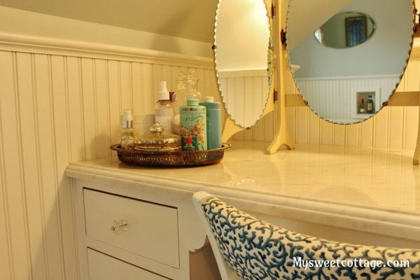 15 Custom built-in cabinetry to use all the space in a dormer window remodel, make-up desk, My Sweet Cottage featured on @Remodelaholic