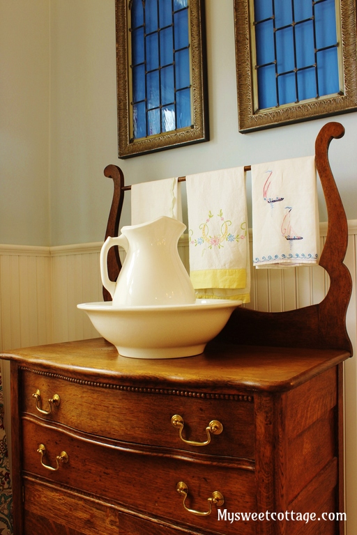 21 Antique washstand and wash basin complement 1920s cottage bathroom remodel, My Sweet Cottage featured on @Remodelaholic
