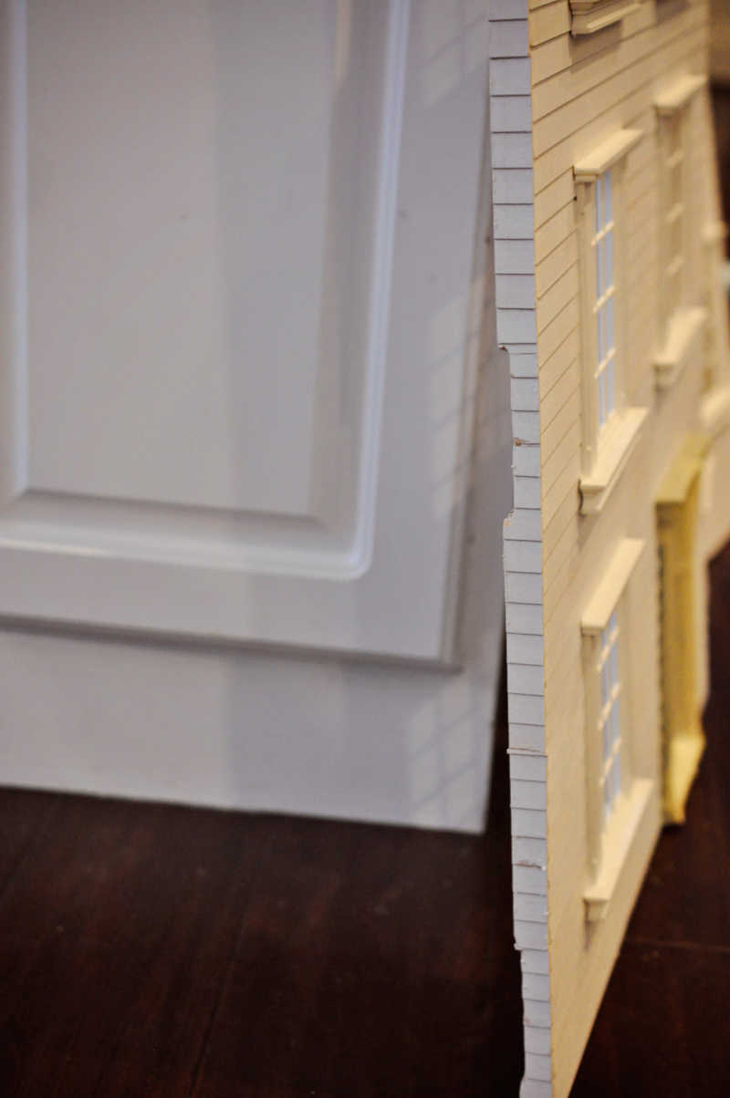How to build a DIY dollhouse hair accessory storage box, to hold headbands, hair bows, bobby pins, and more. Full tutorial on Remodelaholic.com