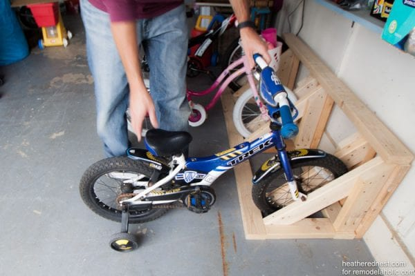 Easy DIY bike rack tutorial to organize your garage NOW! Remodelaholic.com via heatherednest.com