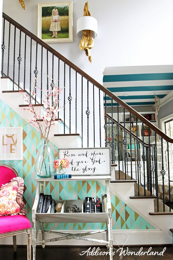 Amazing statement wall in an entry foyer! That console table with storage underneath is great, too. And did you see the striped ceiling... gotta check out the whole house!   100+ Beautiful Mudrooms and Entryways at Remodelaholic.com