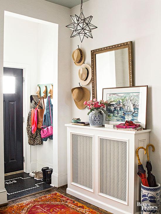entryway with console table built around a radiator, via BHG