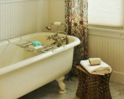 feat Dormer-window-bathroom-1920s-cottage-authentic-remodel-with-claw-foot-tub-My-Sweet-Cottage-featured-on-@Remodelaholic