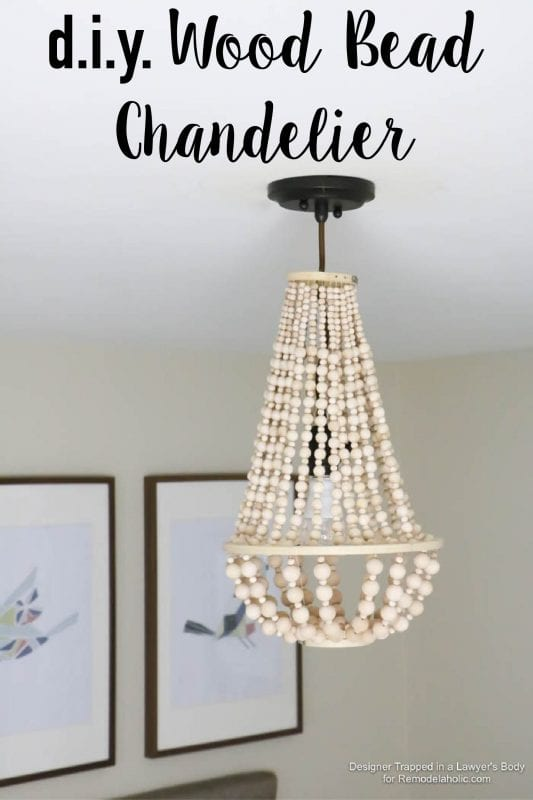 Remodelaholic how to make a wood bead chandelier come learn how to make your own wood bead chandelier with this awesome tutorial aloadofball Image collections