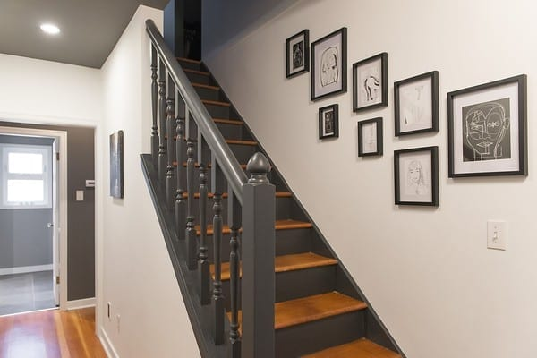 I love this dark two tone stair and deep gray, almost black, stair rail. Paint color is Benjamin Moore Wrought Iron.