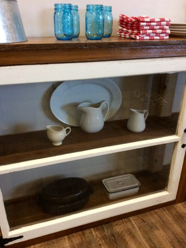 13 Use old windows to create a display case, buffet bar, console table, The Weekend Country Girl featured on @Remodelaholic