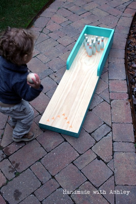 Remodelaholic diy indoor outdoor bowling lane 3 do it yourself from scrap wood bowling lane for kids handmade by ashley solutioingenieria Images