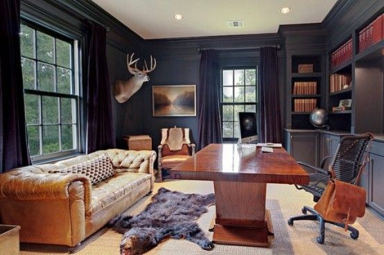 Interesting black office space, love the sofa