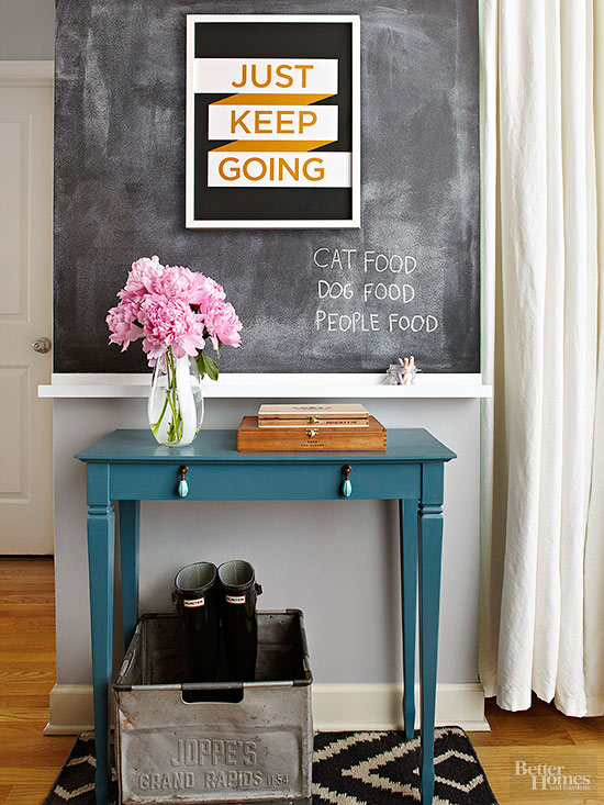 Chalkboard Entryway, love the use of a picture ledge to hold the chalk | 100+ Beautiful Mudrooms and Entryways at Remodelaholic.com