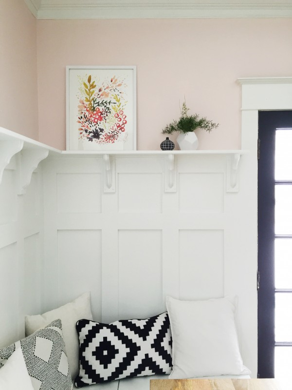 This board and batten wainscoting wall treatment above this dining room banquette is PERFECT!