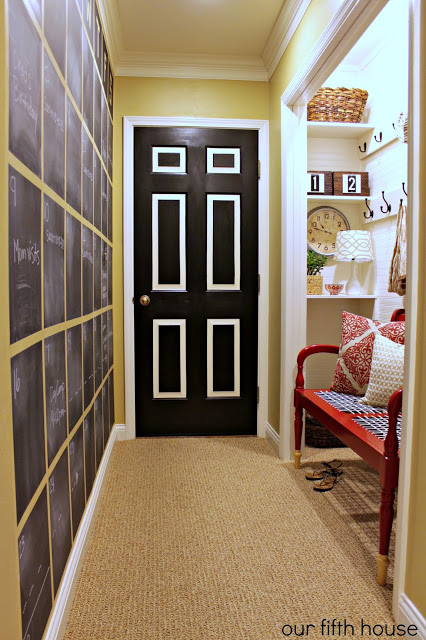 Mudroom Hallway, closet turned mudroom plus chalkboard calendar on the wall | 100+ Beautiful Mudrooms and Entryways at Remodelaholic.com
