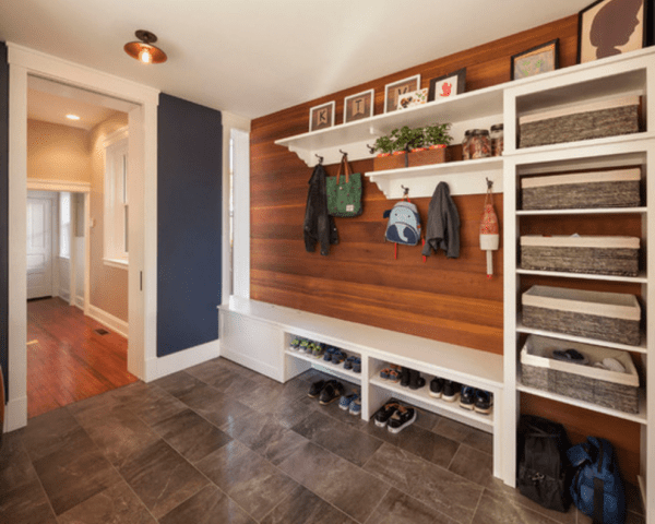 Contemporary mudroom, love the combo of the dark blue with the wood and all the shelves for storage and shoes | 100+ Beautiful Mudrooms and Entryways at Remodelaholic.com