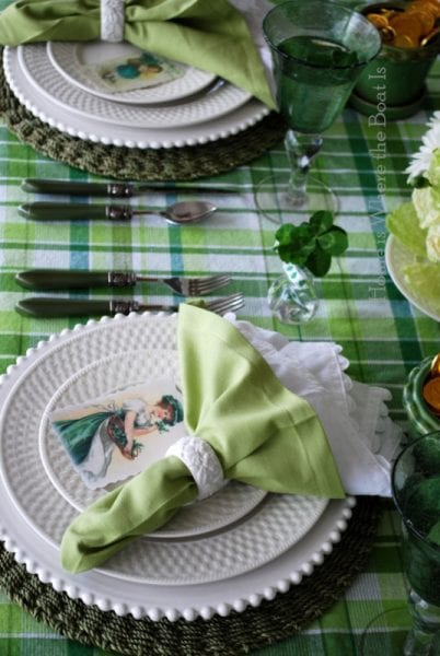 St Patrick's Day green table setting with flowers and plaid and vintage printed placecards, Home is Where The Boat Is