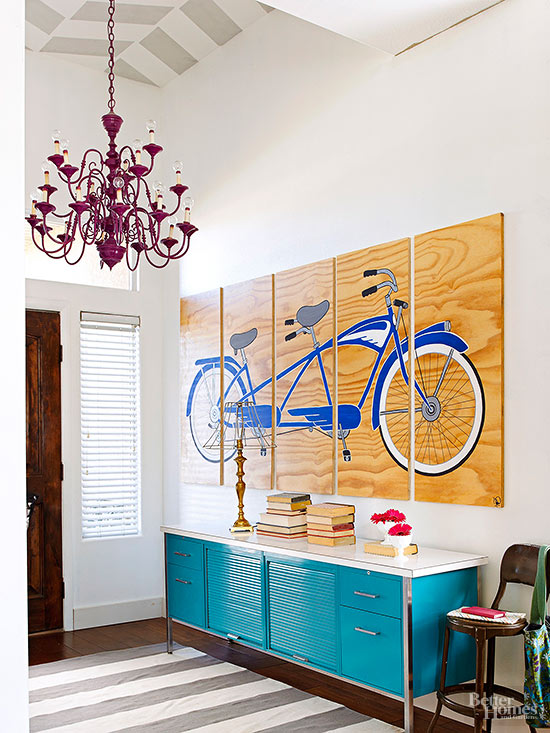 This foyer makes such a big statement on entering the house. Patterned ceiling, huge statement art (painted on plywood!) and that turquoise metal cabinet is awesome.   100+ Beautiful Mudrooms and Entryways at Remodelaholic.com
