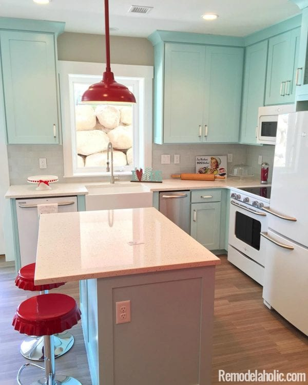 Super cute retro kitchen with light blue cabinets and red fixtures. LOVE IT! @Remodelaholic