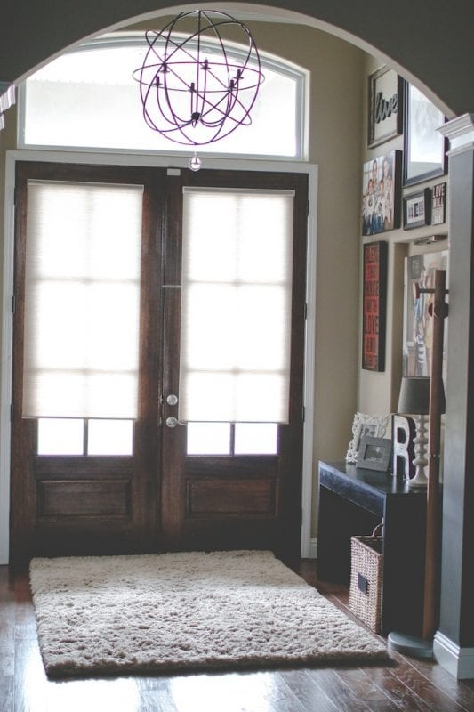 Unique Entryway Gallery Wall   100+ Beautiful Mudrooms and Entryways at Remodelaholic.com