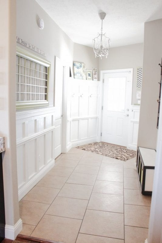 White Entryway, so welcoming and beautiful with the wainscoting | 100+ Beautiful Mudrooms and Entryways at Remodelaholic.com