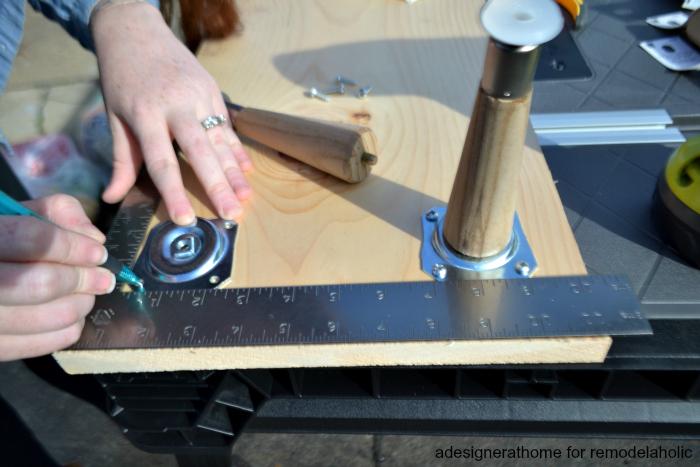 adesigner at home for remodelaholic marking screw holes for furniture leg plates