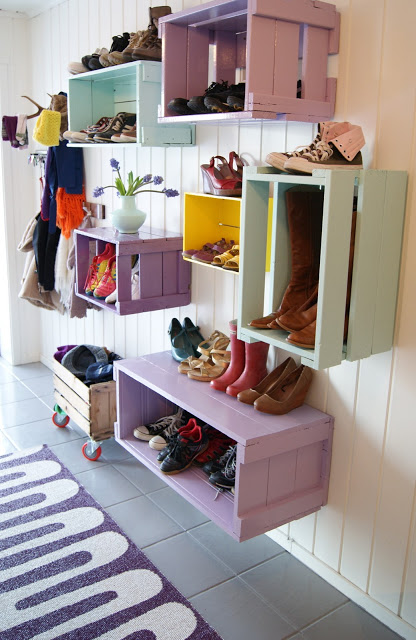 Such a great entryway, colorful crates hung on the wall for shoe storage | 100+ Beautiful Mudrooms and Entryways at Remodelaholic.com