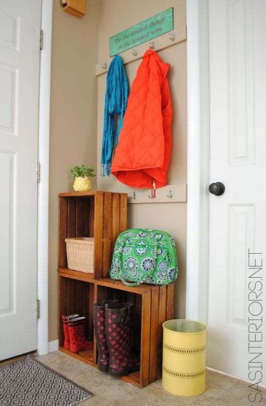 So easy! Stacked crates plus wall hooks fora mini mudroom | 100+ Beautiful Mudrooms and Entryways at Remodelaholic.com