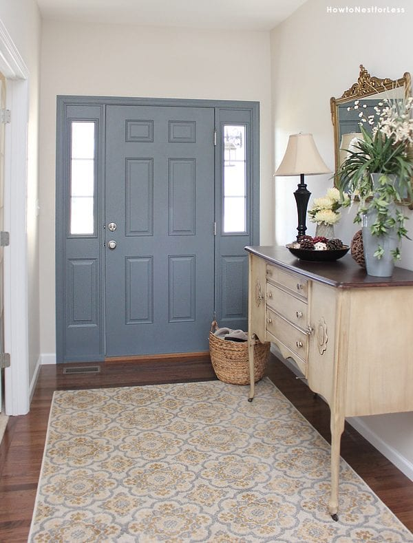 Love the gray-blue door and the rug | 100+ Beautiful Mudrooms and Entryways at Remodelaholic.com