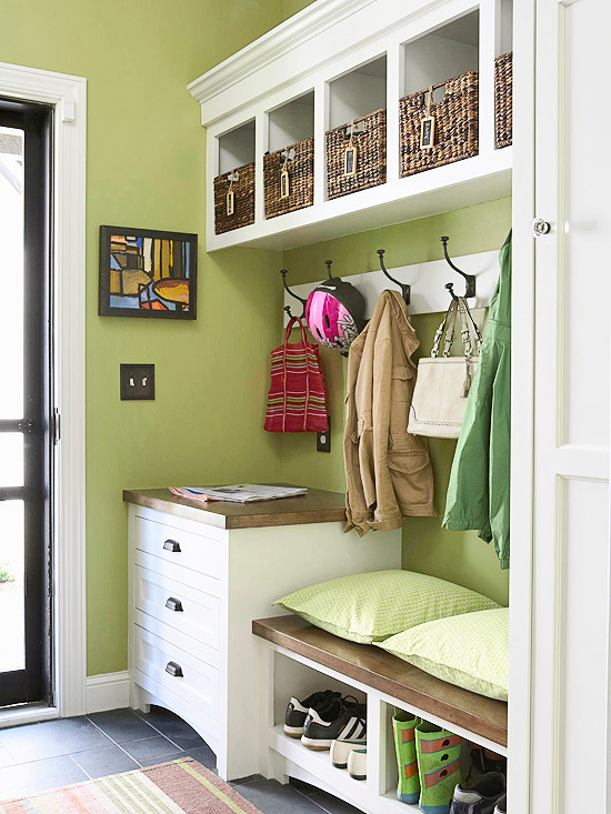 This green mudroom is perfect. Built-in storage for shoes, plus drawers and hooks and cubbies overhead.   100+ Beautiful Mudrooms and Entryways at Remodelaholic.com