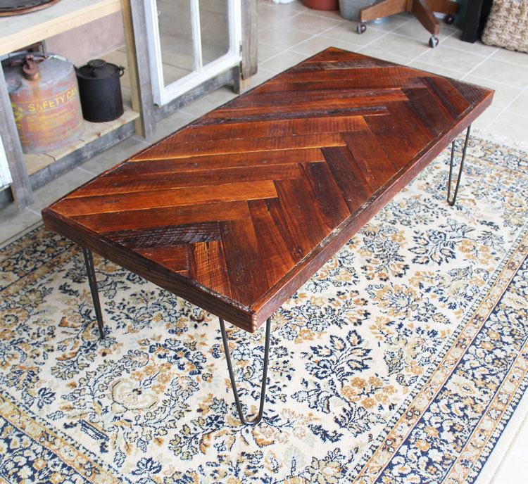 This DIY herringbone coffee table is beautiful! She used reclaimed wood but  you could get - Remodelaholic DIY Wood Herringbone Coffee Table With Hairpin Legs