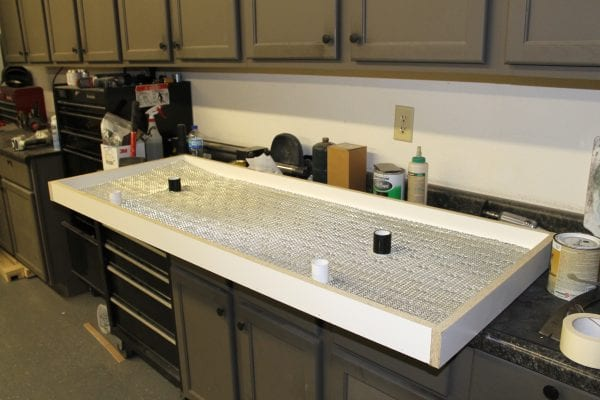 how to make your own solid concrete DIY countertops with forms and tinted concrete (1)