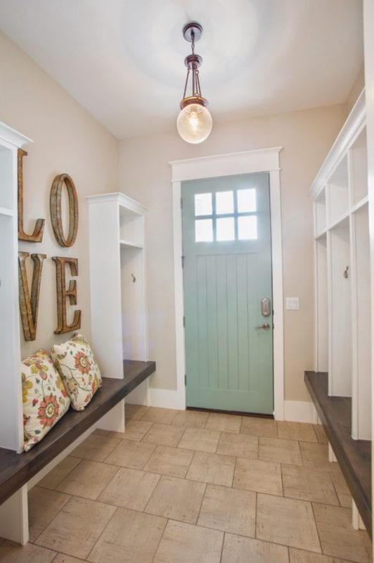 Love this mudroom with the thick wood bench and tall cubby lockers. | 100+ Beautiful Mudrooms and Entryways at Remodelaholic.com