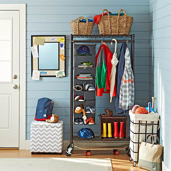 organized entryway with a rolling coat rack closet and baskets   100+ Beautiful Mudrooms and Entryways at Remodelaholic.com