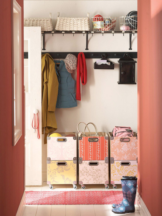 Red mudroom with rolling storage crates and shaker peg coat hooks. Love the patterned boxes!   100+ Beautiful Mudrooms and Entryways at Remodelaholic.com