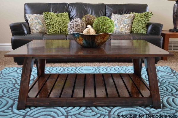 Inspired by a coffee table in a HGTV dream home. I love the trapezoid base and slats that make up this table. DIY slat coffee table with free plans.