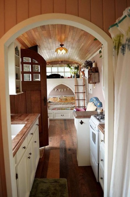 tiny house inside a converted school bus