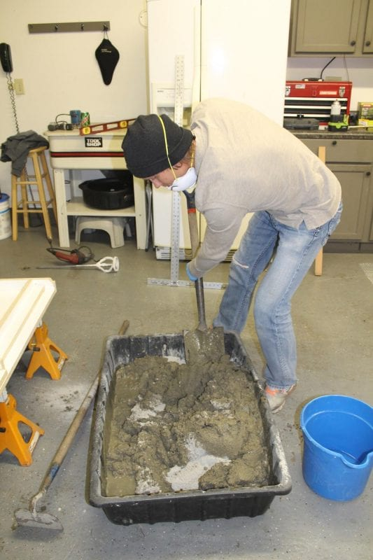 how to mix and tint concrete to make your own concrete countertops, budget friendly DIY job!