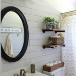 Farmhouse style bathroom with diy shiplap by Tale of an Ugly House on @Remodelaholic