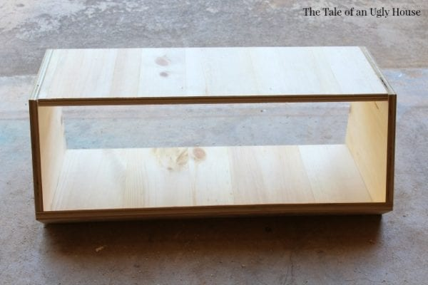 Three tier toy organizer DIY tutorial by Tale of an Ugly House featured on @Remodelaholic