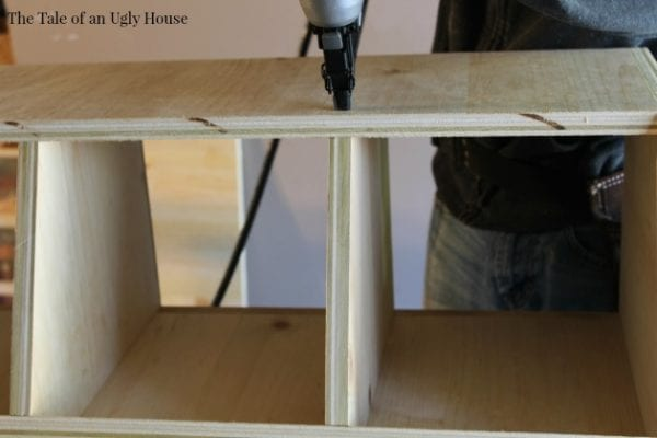 DIY wooden toy organizer by Tale of an Ugly House featured on @Remodelaholic