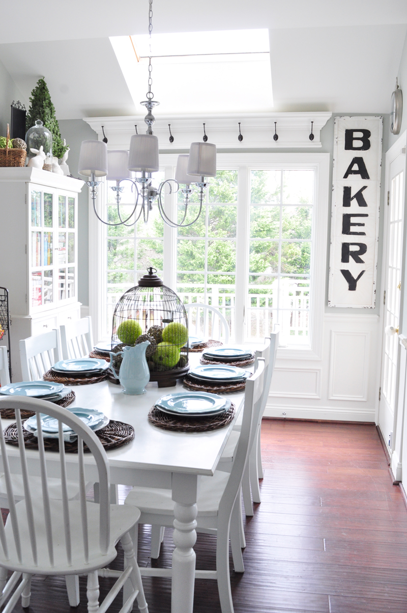 Build an above-window shelf with hooks, perfect for a country cottage kitchen! Tutorial on Remodelaholic.com