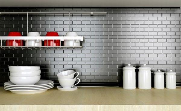 Ceramic kitchenware on the wooden worktop. Black and white kitchen design.