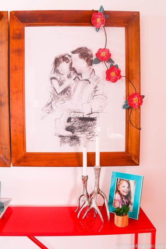 This beautiful paper flower garland looks stunning draped over artistic family portraits in wood frames. Great for party decor or anywhere you need a little color. Free printable from @Remodelaholic and Canon.