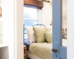 Tera-Janelle-Travel-Inspired-Bedroom-with-Brick-Remodelaholic-1-2-feat
