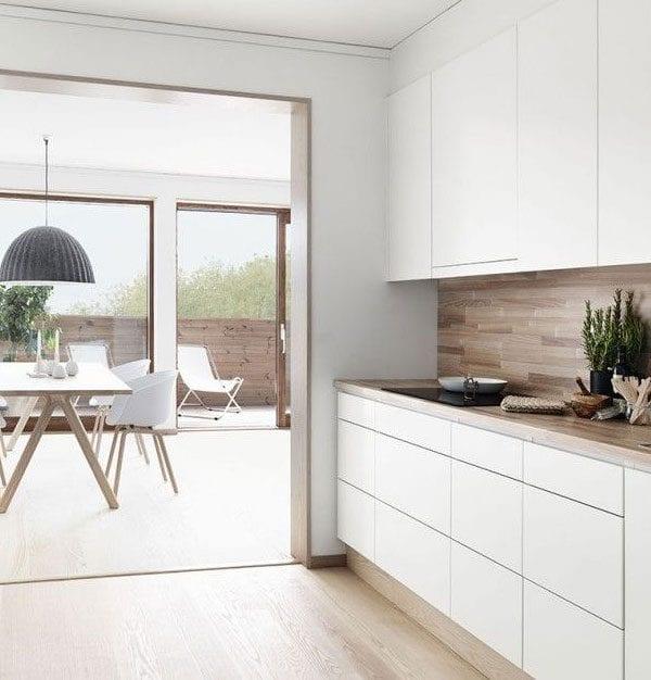 White Kitchen with Wood Looking Backsplash Apartment 34